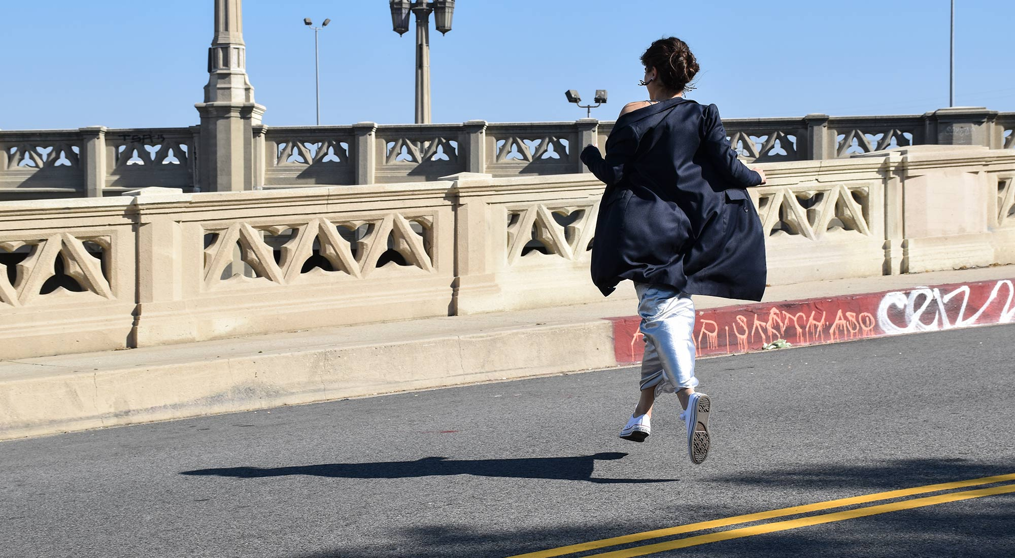 Jumping on The Bridge in a Silk Dress